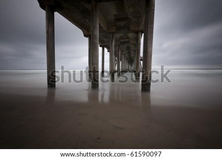 Under the Huntington Beach Pier Long Exposure - stock photo