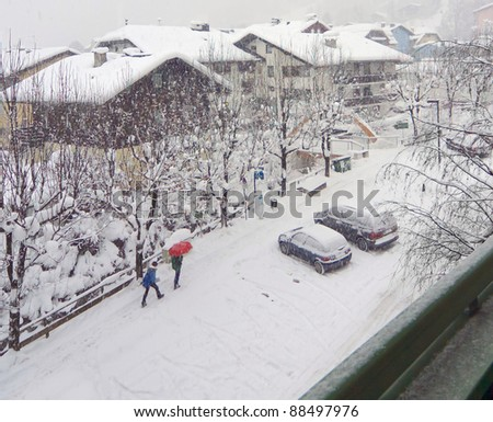 Under the red umbrella in the snow - Zell-am-See, Austria