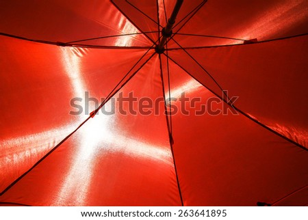 under the red umbrella structure