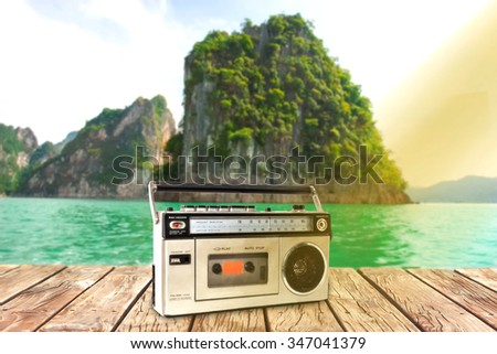 Under the  sky,platform beside Lake and old cassette player - stock photo
