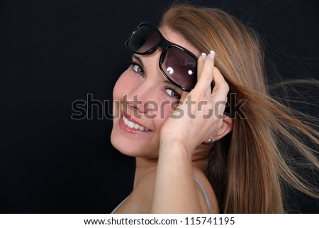 Under the sunglasses - stock photo