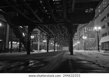 Under the tracks in downtown Chicago. - stock photo