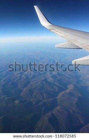 Under the wing of the plane mountains