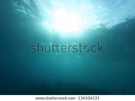 Under water sun ray. - stock photo