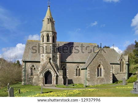 Underbarrow church with Spring Daffodils - stock photo