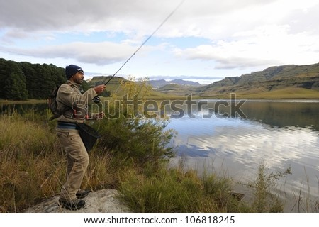 UNDERBERG,SOUTH AFRICA -APRIL 25: Unidentified flyfisherman tries for a trout on April 25,2011 at Giant's Cup Wilderness Reserve in the Drakensberg. The reserve is an iconic trout fishing destination.
