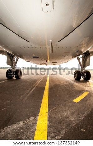Undercarriage of jet plane - aircraft pictured from below - stock photo