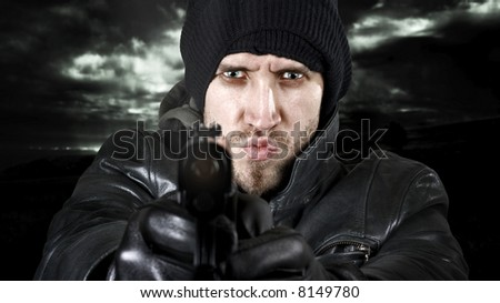 Undercover agent or delinquent firing handgun in the camera. - stock photo