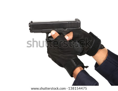 Undercover policeman wearing a hood balaclava, aiming at your face with a semi automatic gun - stock photo