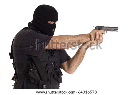 Undercover policeman wearing a hood balaclava, aiming sideways with a semi automatic gun - stock photo