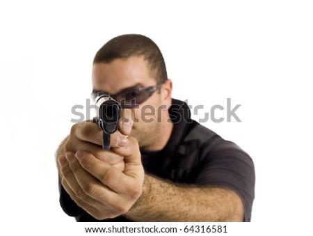 Undercover policeman with a rough look, aiming at you with a semi automatic gun - stock photo