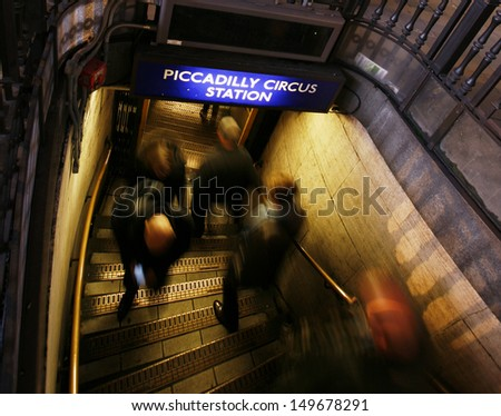 Underground Entrance at Piccadilly Circus, Night view, commuters present.   - stock photo