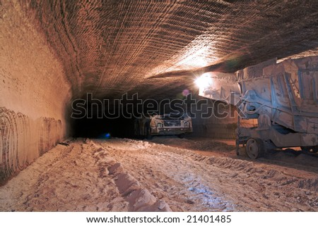 Underground mine drive with mining machines - stock photo
