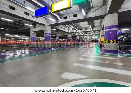 Underground parking aisle - stock photo