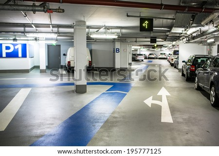 Underground parking/garage (color toned image; shallow DOF) - stock photo