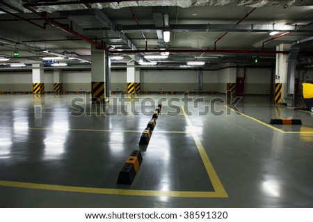 Underground parking of shopping centre, free from cars - stock photo