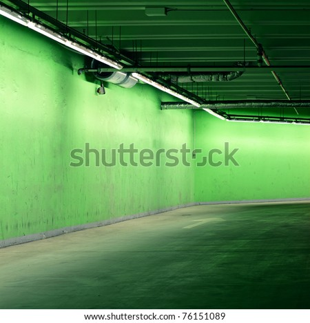 Underground parking painted in green - stock photo