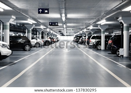 Underground parking with cars. White colors. - stock photo