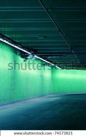 Underground parking with green walls - stock photo