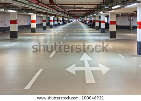 underground parking with road markings and arrows