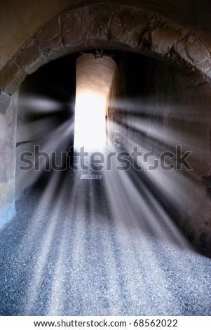 underground passage crossed by sun beam - stock photo