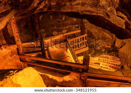 Underground staircase at salt mine corridor. Tunnel in a cave - stock photo
