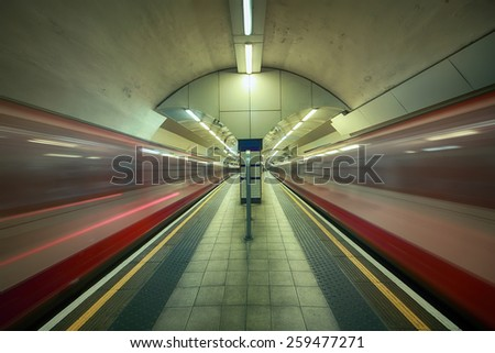 underground station in London with two passing trains - stock photo