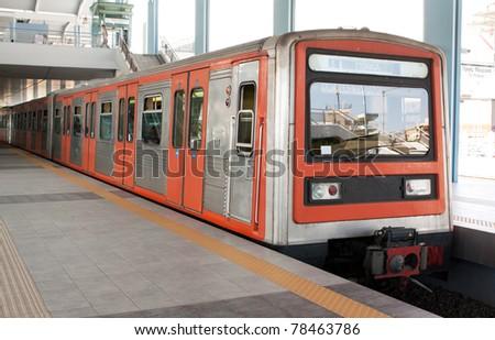 Underground station in Piraeus area, Athens, Greece, and train running from Piraeus to Monastiraki. - stock photo