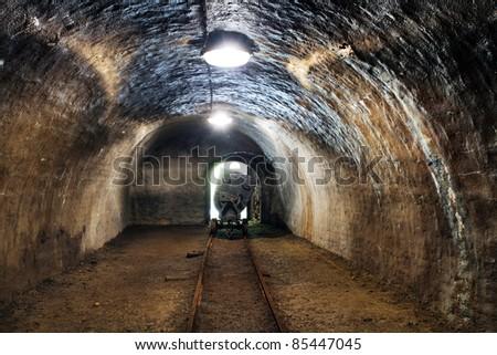 Underground train in mine, carts in gold, silver and copper mine. - stock photo