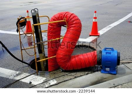 Underground work. Open manhole. - stock photo