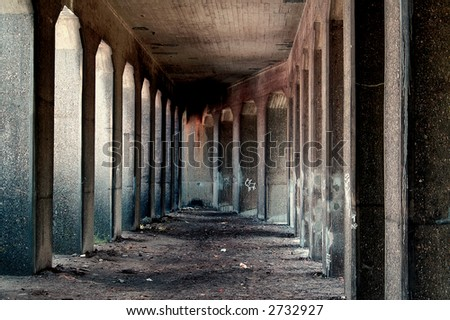 Underneath an old concrete bridge. - stock photo