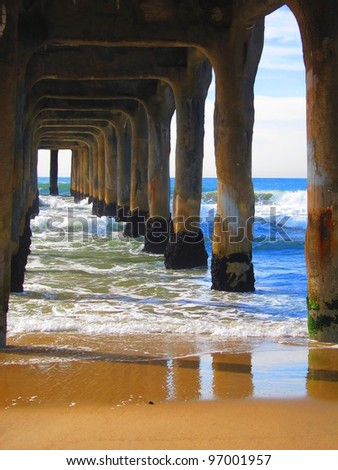 underneath of a large pier - stock photo
