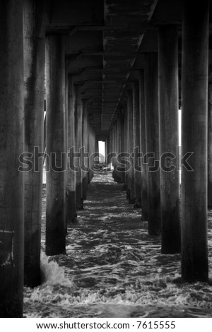 underneath The World Famous Huntington Beach Pier in black and white - stock photo