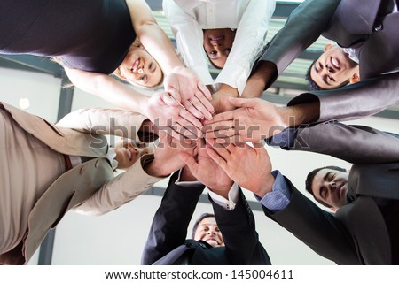 underneath view of business people hands together - stock photo
