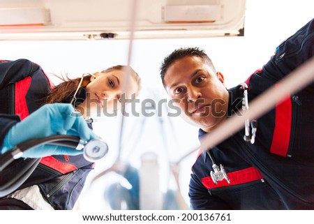 underneath view of paramedic team giving first aid to patient - stock photo