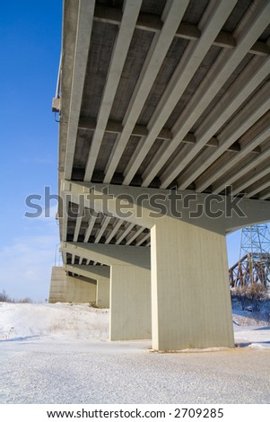 Underside of a concrete ramp leading to the Pierre Laporte Bridge - stock photo