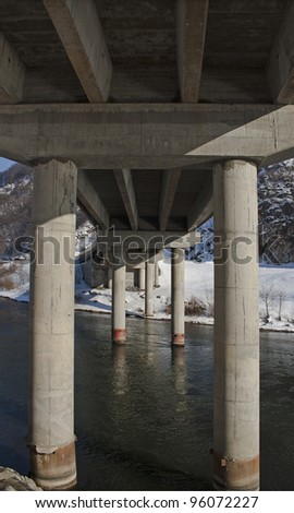 Underside of Concrete bridge - stock photo