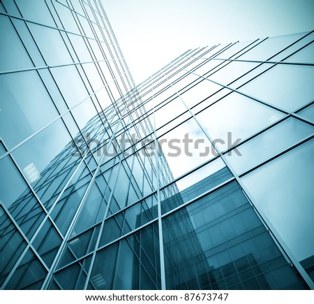 underside view to steel glass high rise building - stock photo