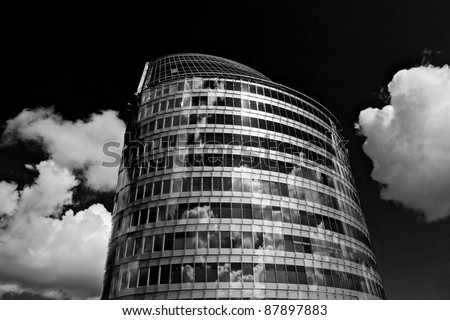 underside view to steel glass high rise building. Black-white photo. - stock photo