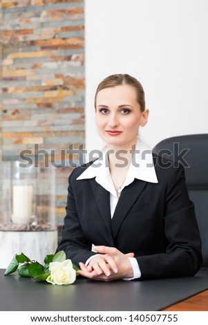 Undertaker for the funeral is giving solace in the funeral parlor - stock photo