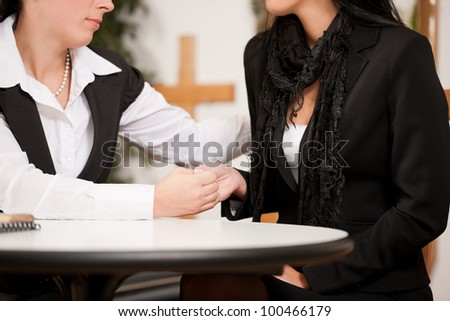 Undertaker is advising a client for the funeral and is giving her solace - stock photo