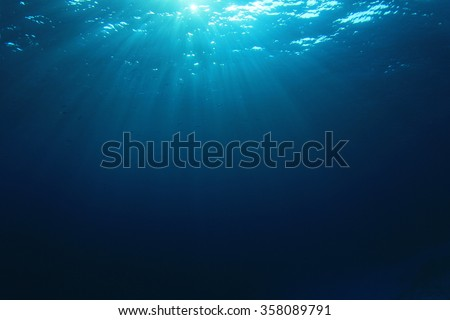 Underwater blue background in sea - stock photo