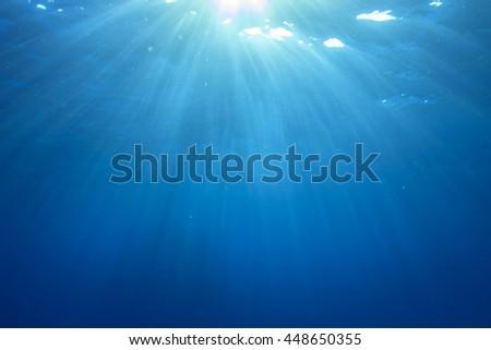 Underwater blue background in sea - stock photo