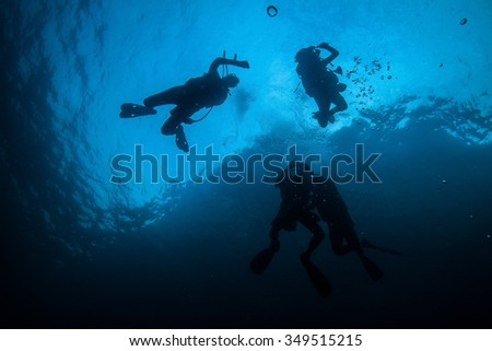 Underwater Blue Sea and diver on the surface  - stock photo