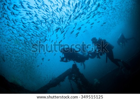 Underwater Blue Sea and scuba divers - stock photo