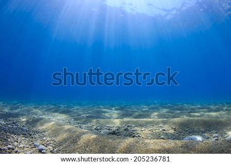 Underwater Blue Sea Background Photo - stock photo