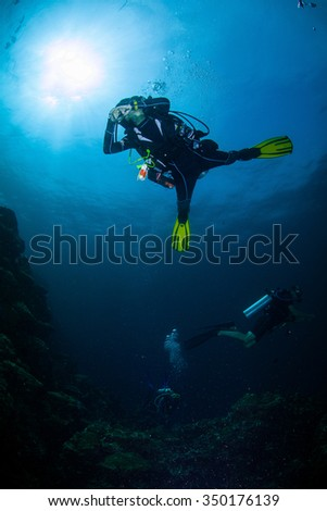 Underwater deep blue sea and scuba diver