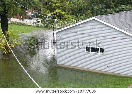 Underwater flooding in a backyard. - stock photo
