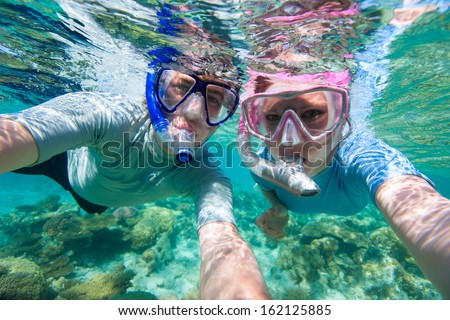 Underwater photo of a couple snorkeling in ocean - stock photo