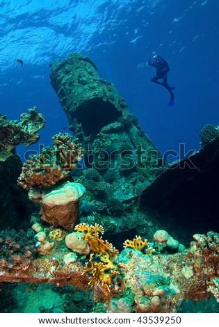 Underwater photographer and wreck - stock photo